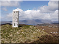 NG8328 : Trig point of Auchtertyre Hill by Trevor Littlewood
