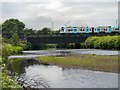 SD7909 : River Irwell, Metrolink Bridge by David Dixon