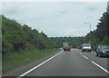 SK6177 : A57 east approaching warning signs for B6040 roundabout by John Firth