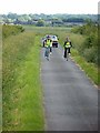 TF0571 : Cyclists on Five Mile Lane by Oliver Dixon