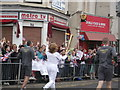 TQ7767 : Olympic Torch Runner on Canterbury Street, Gillingham by David Anstiss