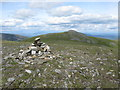 NN6949 : Cairn on the minor top of Meall nan Aighean by G Laird