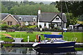 NH6140 : Caledonian Canal: boat and cottage at Dochgarroch by David Martin