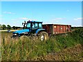 SU0698 : New Holland tractor, Driffield Cross Roads, Gloucestershire by Brian Robert Marshall