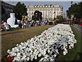 TQ2780 : Flower Bed at Cumberland Gate by Colin Smith