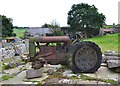 SK1679 : Old tractor at a farm entrance in Coplow Dale by Neil Theasby