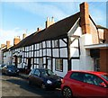 SO7225 : Row of 5 black and white timber-framed houses, Newent by John Grayson