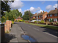 Dist:0.4km<br/>A view of the eastern end of Liberty Lane, a residential road in Addlestone.