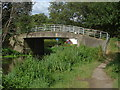Dist:0.2km<br/>The footbridge over the River Wey Navigation named after the nearby farm.