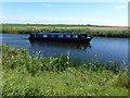 TL4598 : Narrow boat heading towards March by Richard Humphrey