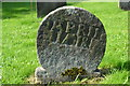 SK1355 : Very old gravestone in Alstonefield churchyard by Neil Theasby