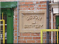 SK8053 : Devon Brewery, inscribed stone by Alan Murray-Rust