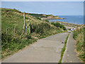 TA0684 : Cleveland Way crosses the beach access road by Pauline Eccles