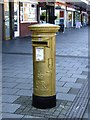 SK0500 : Gold postbox on the High Street by John M