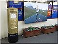 TL3990 : Gold postbox for Jonnie Peacock in Doddington by Richard Humphrey