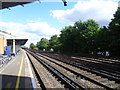 TQ2369 : The up platform at Raynes Park station by Ian Yarham