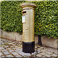 SJ9884 : Sarah Storey's Gold Postbox, Disley by David Dixon