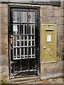 SJ9784 : Barney Storey's Golden Postbox in Disley by David Dixon