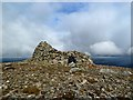 NH9911 : The summit cairn of Meall a' Bhuachaille by Walter Baxter