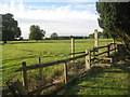 TF1145 : Double stile and sheep pasture at Asgarby by Jonathan Thacker