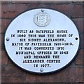 Photo of Sidney Alexander white plaque