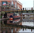 SP0686 : Canal and footbridge by Andrew Hill