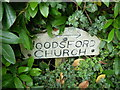 SY7690 : St John the Baptist, Woodsford: sign by Basher Eyre