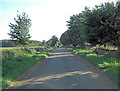 SP1408 : Unnamed road passes Swire Barton by Stuart Logan