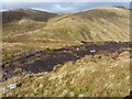 NN4343 : Peaty ground on the north side of Meall Phubuill by Richard Law