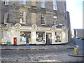 NT2474 : Stockbridge Pharmacy and postbox by Stanley Howe