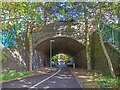 SP1479 : Railway bridge over footpath and cycleway by David P Howard