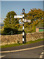 NY5863 : Signpost at Low Row by David Dixon