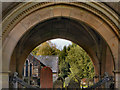 NY8773 : St Mungo's Church and Lychgate Arch by David Dixon