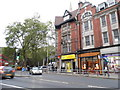 TQ2579 : Shops on High Street Kensington by David Howard