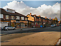 SJ8585 : Heald Green, Shops on Wilmslow Road by David Dixon
