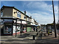 SJ3988 : Suburban shops, Woolton Road by Peter Barr