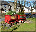 SH5848 : Red former mining trucks, Beddgelert by John Grayson