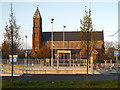 SJ8898 : Clayton Hall Tram Station and St Cross Parish Church by David Dixon