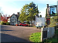 SO7225 : Black Dog pub car park and pub sign, Newent by John Grayson