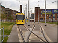 SJ8497 : Tram on Test by David Dixon