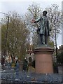 TQ3782 : Statue of Gladstone with red hand at Bow Church by David Smith