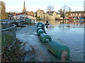TL2470 : Flood water surging through a sluice in Godmanchester by Richard Humphrey