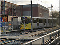 SD9408 : Metrolink Tram Arriving at Shaw and Crompton by David Dixon
