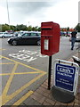 SJ6684 : Lymm: postbox № WA13 119, M6 services by Chris Downer