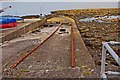 J5182 : Small pier with rails near Seacliff Road, Ballyholme, Bangor by P L Chadwick