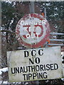 SY6394 : Grimstone: signs at D.C.C. depot entrance by Chris Downer