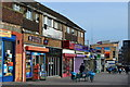 TQ5177 : Colourful parade of shops, Erith by David Martin
