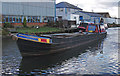 SJ7087 : Coal barge on the Bridgewater Canal by michael ely