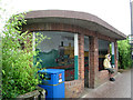 TG1543 : Bus shelter in the rain, Railway Approach by Robin Stott