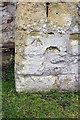 SU4596 : Benchmark on a tower buttress of All Saints Church by Roger Templeman